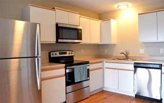 apartment kitchen equipped with stainless steel appliances