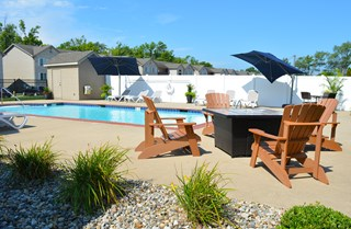 Outdoor pool and fire pit with seating for four