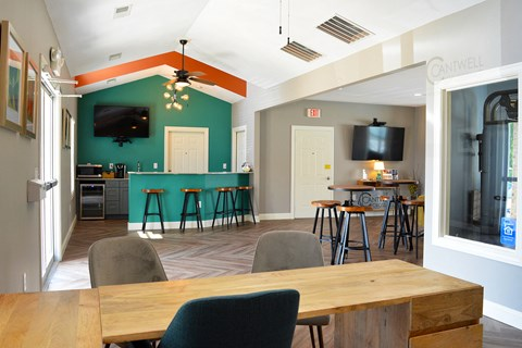 Clubhouse and leasing office with kitchen and counter top seating