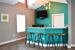 Clubhouse kitchen with counter height bar stool seating