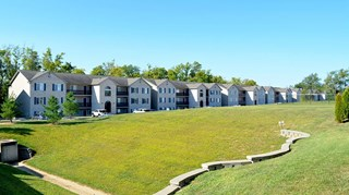 Exterior of apartment buildings and grassy field