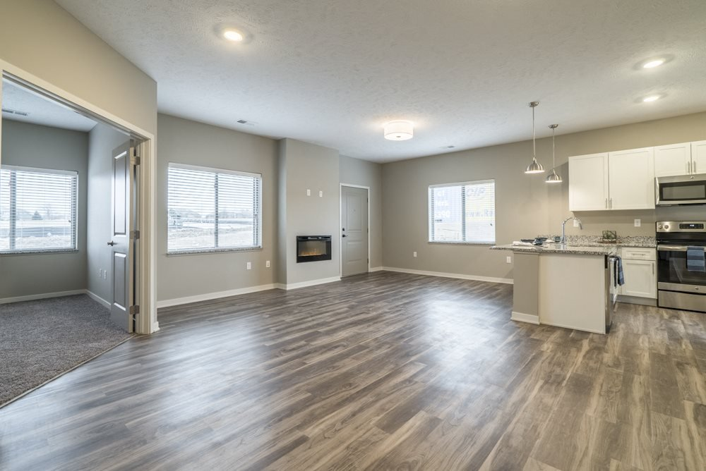 Interiors-2 bedroom apartment with living room and kitchen view at The Villas at Falling Waters