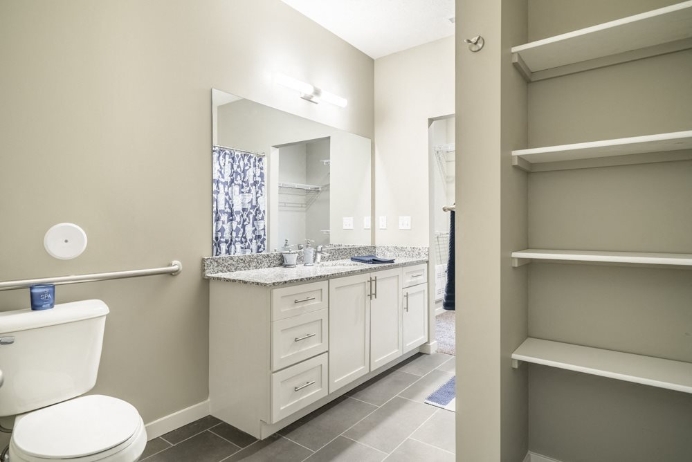 Interiors-Large master bathroom with built-in shelving