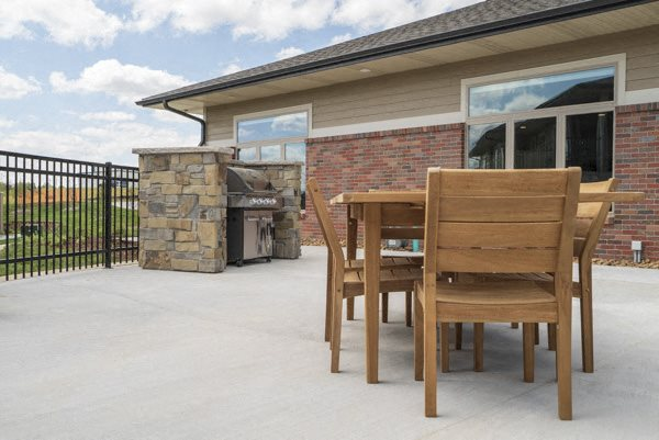 Outdoor table with grill at The Villas at Falling Waters in west Omaha