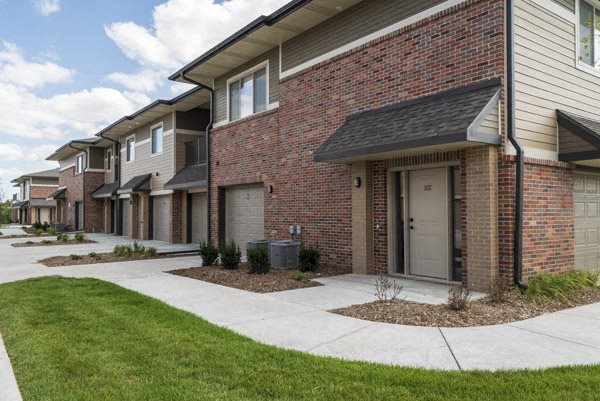 Private entrances and attached garages at The Villas at Falling Waters luxury townhomes in west Omaha NE