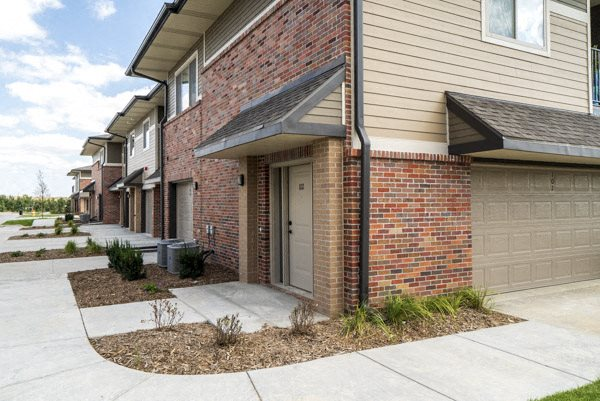 Exterior view of private entrances and garages at The Villas at Falling Waters in west Omaha NE