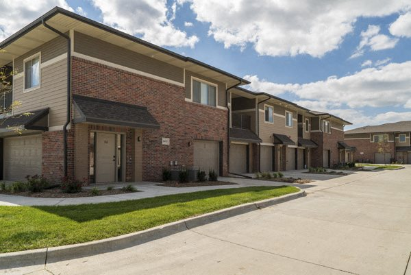 Private entrances and attached garages at The Villas at Falling Waters in west Omaha, NE