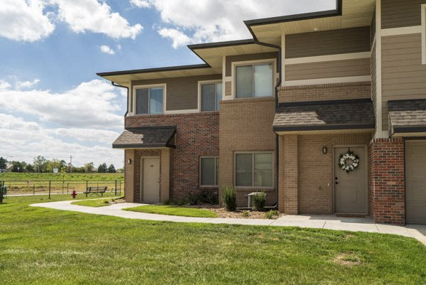 Private entrances with greenspace at The Villas at Falling Waters townhomes in West Omaha NE