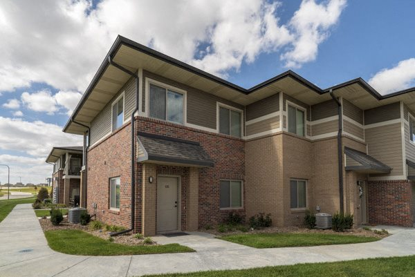 Exterior view of private entrances at The Villas at Falling Waters townhomes for rent in west Omaha NE