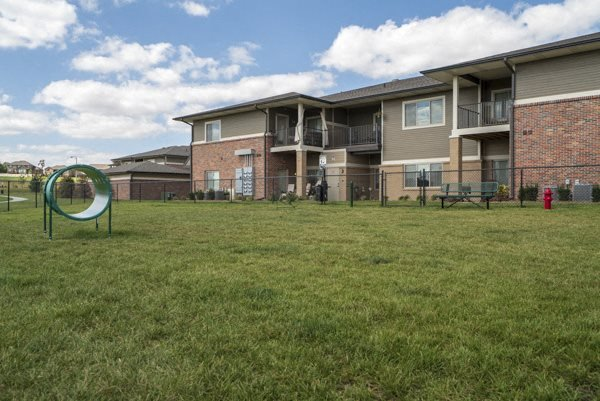 Private dog park with agility equipment at The Villas at Falling Waters townhomes in west Omaha NE