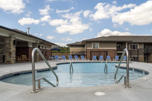 Resort-style pool with shallow soaking area at The Villas at Falling Waters townhomes for rent in west Omaha NE