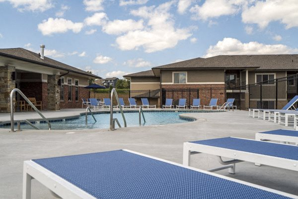 Resort-style pool with lounge seating at The Villas at Falling Waters townhomes in west Omaha, NE