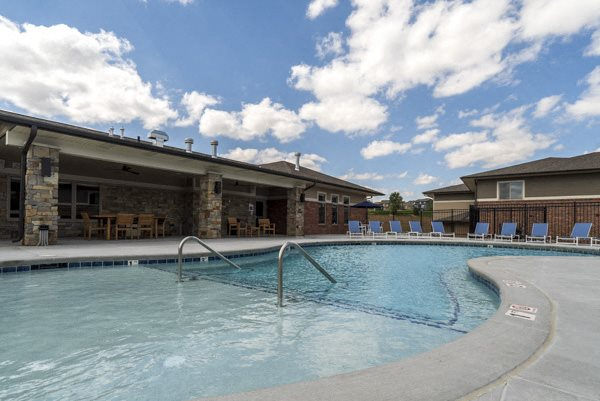 Resort-style pool with lounge seating at The Villas at Falling Waters townhomes for rent in West Omaha NE