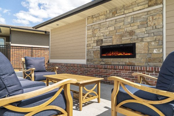 Outdoor fireplace and lounge at The Villas at Falling Waters townhomes for rent in West Omaha