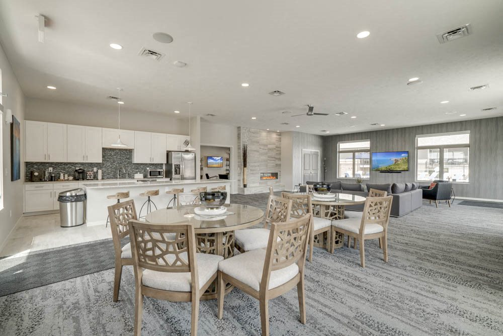 Clubhouse interior with kitchen and TV lounge for resident use at The Villas at Falling Waters townhomes in west Omaha NE