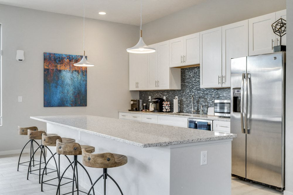 Full kitchen with island in the clubhouse at The Villas at Falling Waters in west Omaha