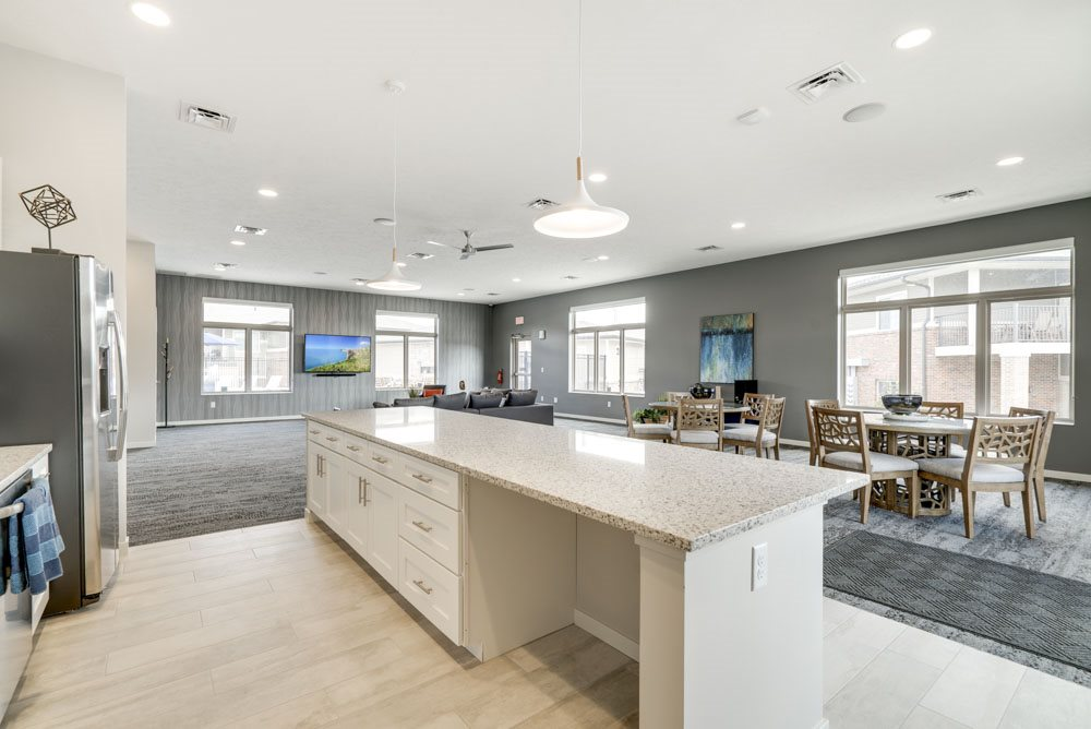 Resident clubhouse with kitchen and TV lounge at The Villas at Falling Waters townhomes in west Omaha NE