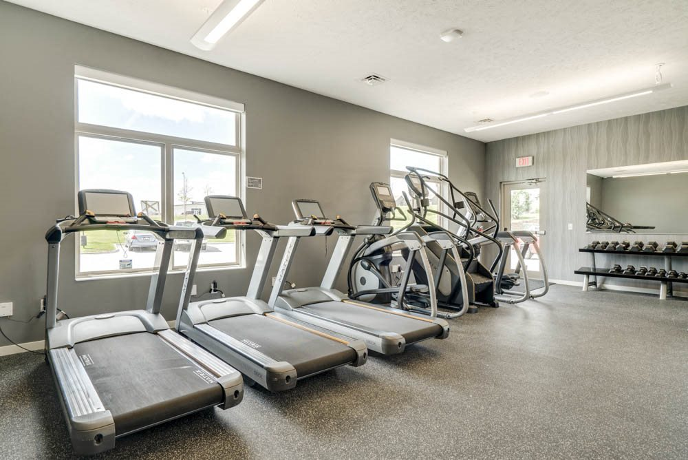 Treadmills and stair climbers in the fitness center at The Villas at Falling Waters in west Omaha