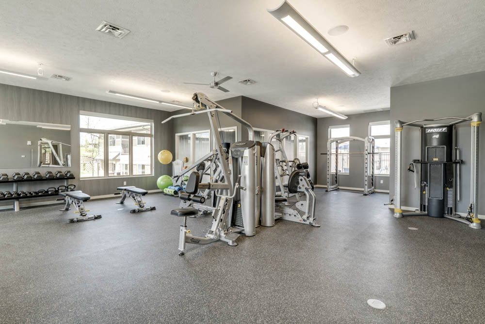 Fitness center with free weights and weightlifting machines at The Villas at Falling Waters townhomes in West Omaha NE