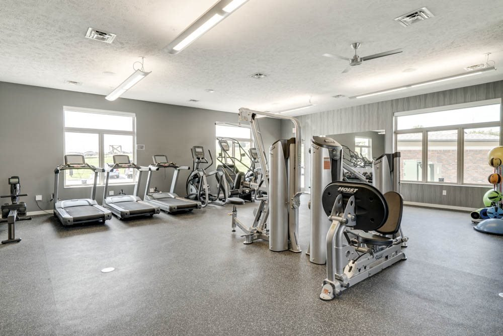Nice fitness center with treadmills and weightlifting machines at The Villas at Falling Waters in west Omaha NE