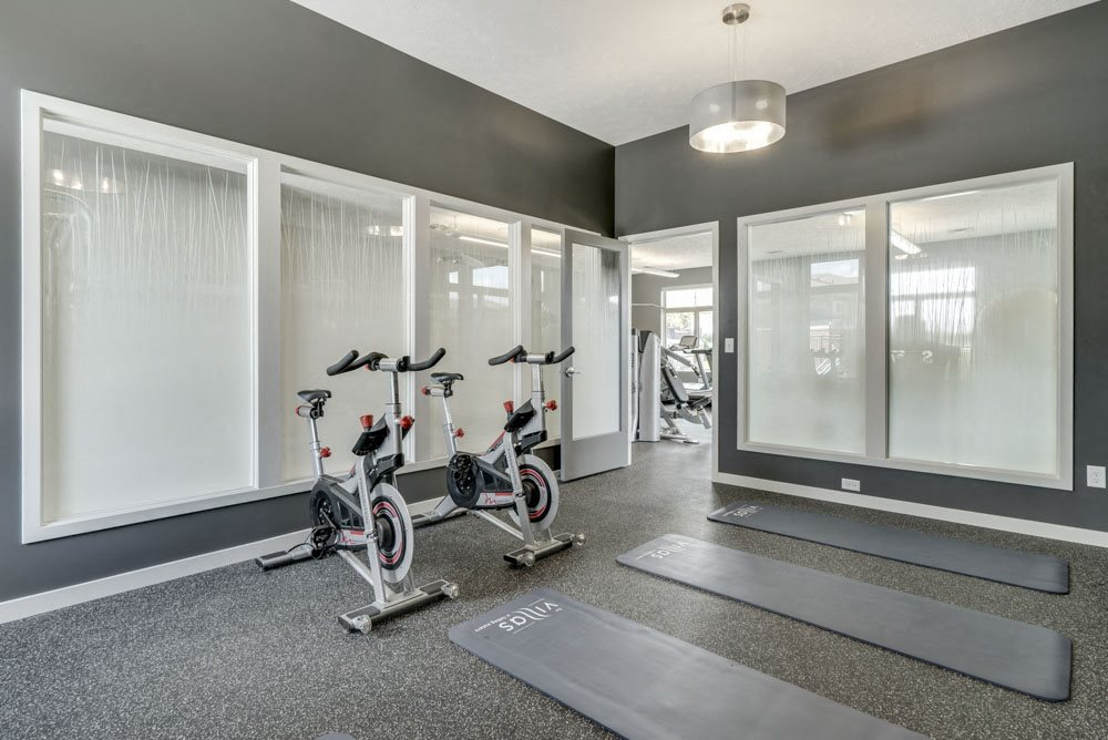 Yoga/spin studio at The Villas at Falling Waters luxury townhomes for rent in west Omaha NE