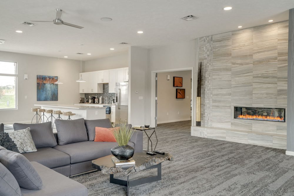 Resident clubhouse with TV lounge and fireplace at The Villas at Falling Waters in west Omaha NE