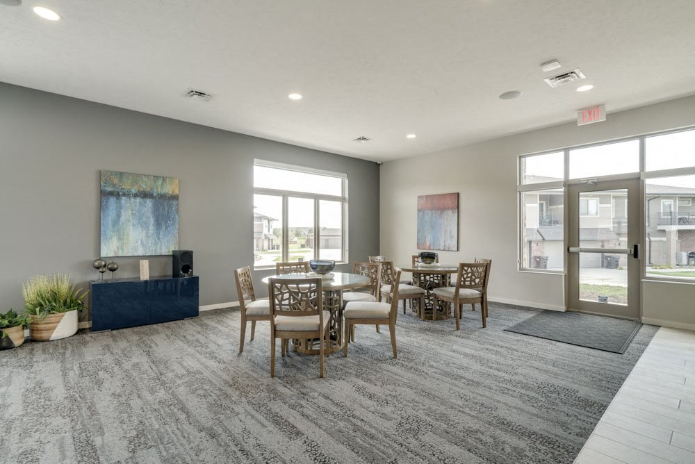 Resident social spaces with chairs and tables at The Villas at Falling Waters townhomes for rent in west Omaha
