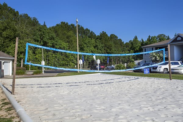 White sand sits under the net ready for action at the volleyball court at Crystal Lake Apartments in Pensacola, FL