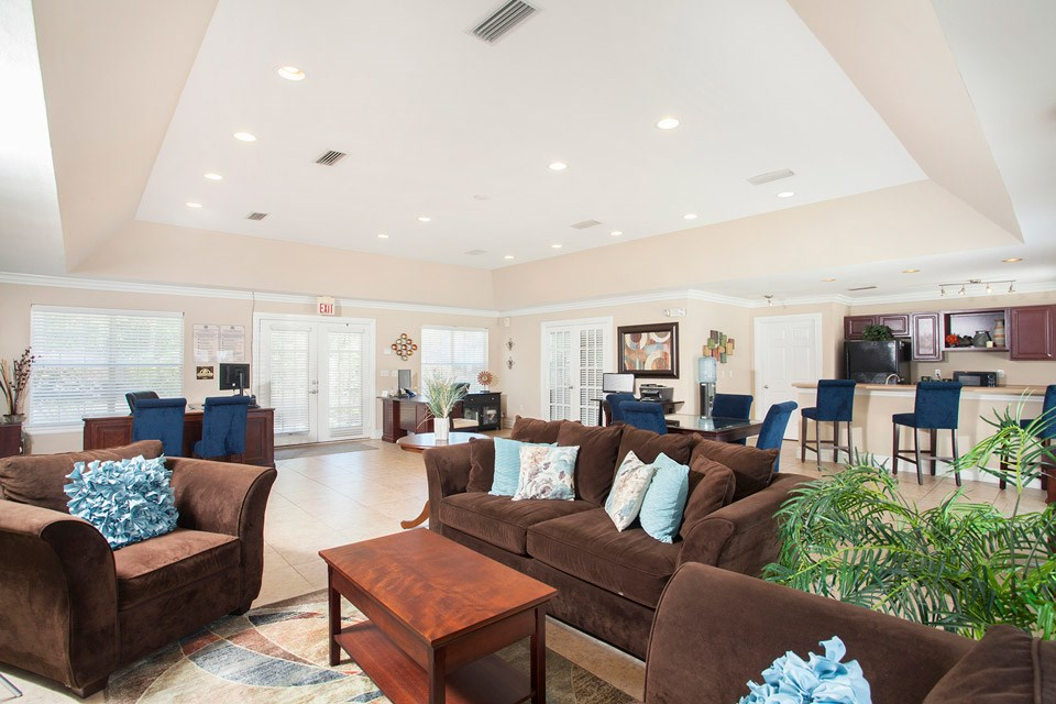 The lobby inside the leasing office has copious seating and amenity options at Crystal Lake Apartments in Pensacola, FL