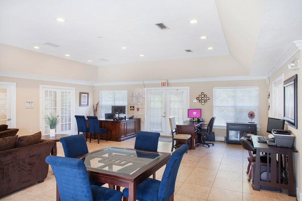 The managing office includes tables, seating, a business center and more at Crystal Lake Apartments in Pensacola, FL