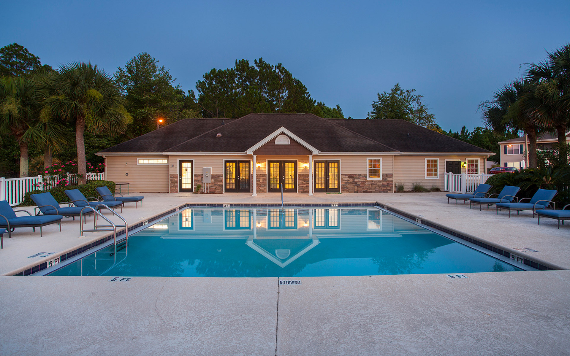 Evening View Of The Pristine Swimming Pool And Leasing Office At Crystal  Lake Apartments In Pensacola
