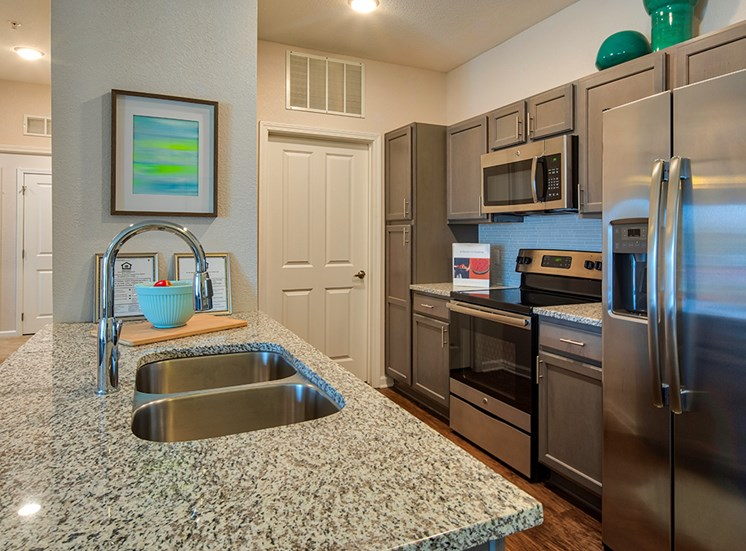 Kitchen with granite counters at The Choices Apartments