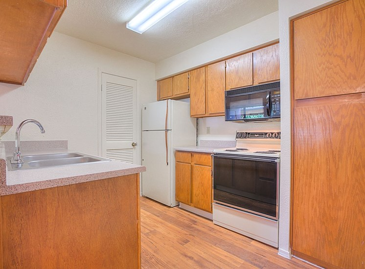 Spacious Kitchen with Pantry Cabinet at The Overlook Apartments, Albuquerque, NM