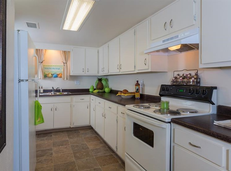 Spacious Kitchen with Pantry Cabinet at The Towers Apartments, 5404 Montgomery Boulevard NE, NM