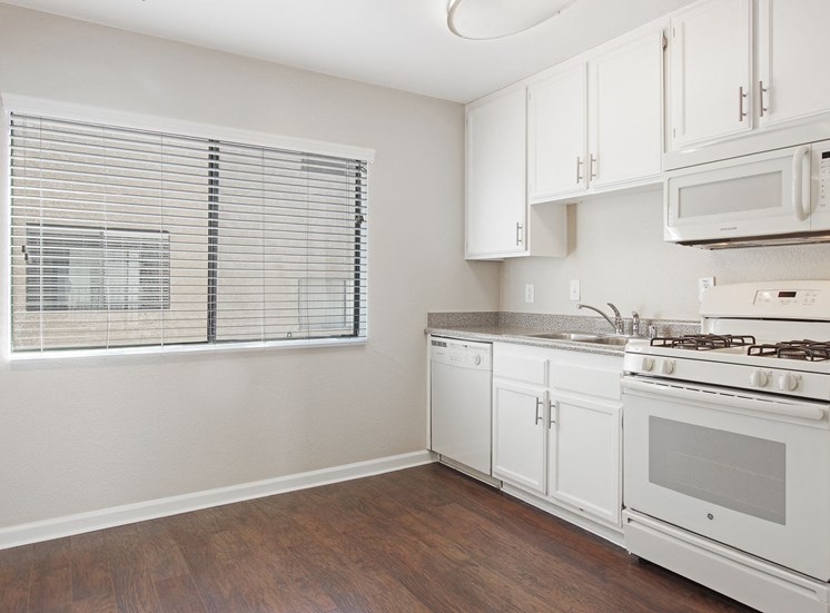 Kitchen With White Cabinetry And Appliances at Superior Place, Northridge, CA