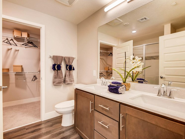 Las Vegas NV Apartments -The Mercer Bathroom With Wooden Flooring and Sleek Cabinets