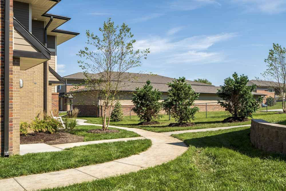 Walk paths and green space at The Villas at Mahoney Park