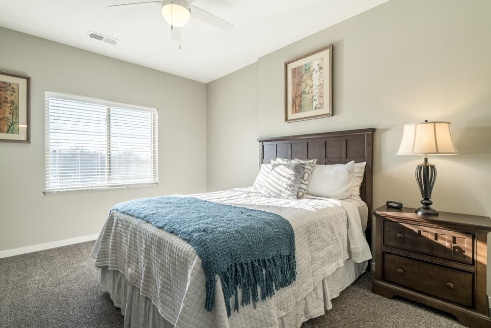Spacious bedroom with lots of natural lighting at The Villas at Mahoney Park