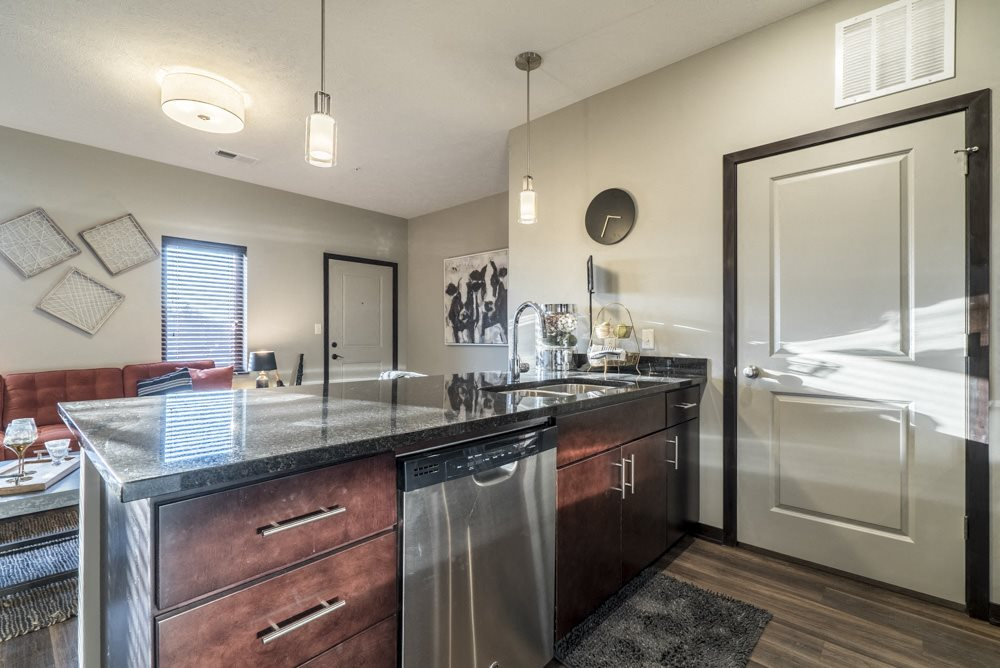 Kitchen with dark cabinets and dark granite counter tops at The Villas at Mahoney Park