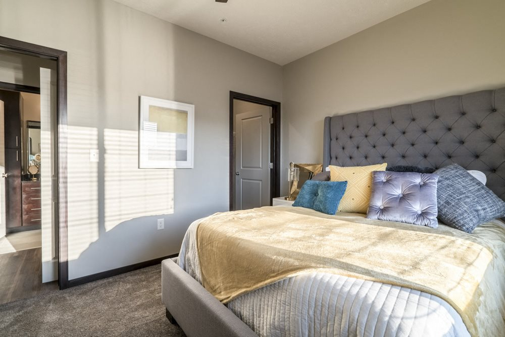 Spacious bedroom large enough to include a king sized bed at The Villas at Mahoney Park