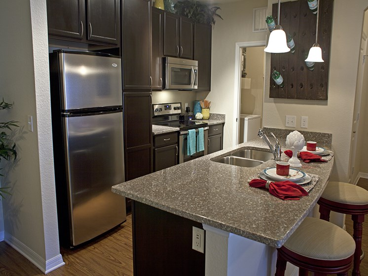 Gourmet Kitchen with Breakfast Bar and Pantry at Phillips Mallard Creek Apartments, Charlotte, NC