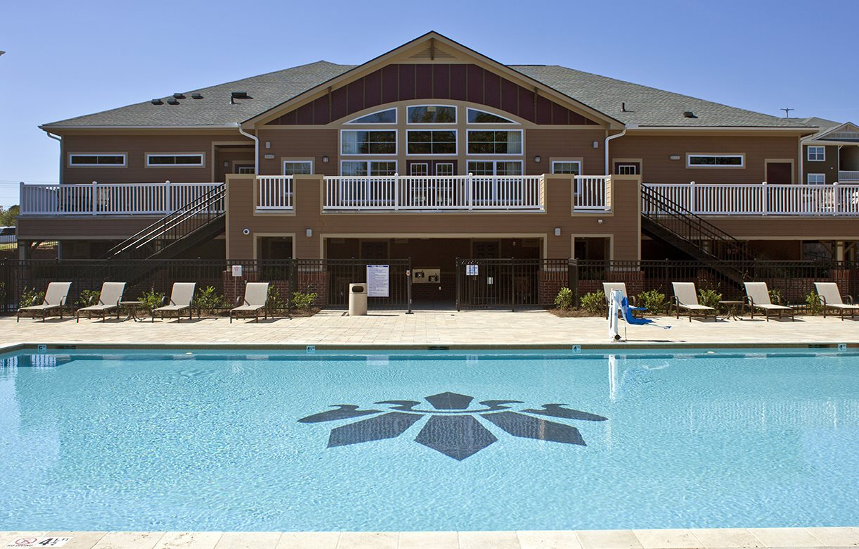 Swimming Pool with Lounge Chairs at Phillips Mallard Creek Apartments, 28262