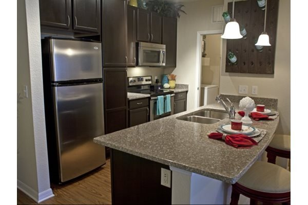 Stainless steel Whirlpool appliances at Phillips Mallard Creek Apartments, North Carolina 28262