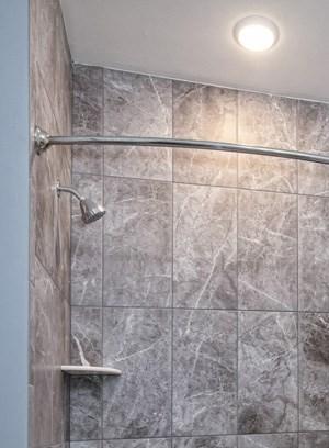 quartz countertops, carrera tile, towel racks, bathtub, shower,