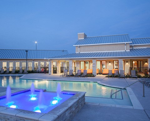 Large pool with water feature  apt buildingsSilverado Crossing Apartments For Rent  l Buda Texas
