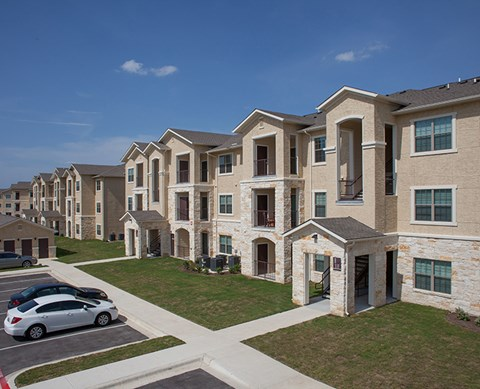 Row of apt buildings and parking  Buda Texas 78610 l Silverado Crossing Apt Rentals