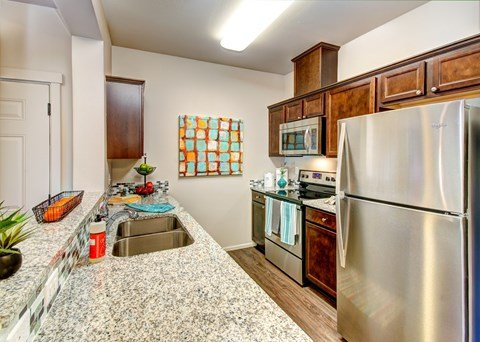 Modern Kitchen with upscale Finishes & Breakfast Bar at The Arbors at Edgewood Apartments, 10304 20th Street E