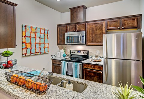 Stainless Steel Appliances & Granite Countertops at The Arbors at Edgewood Apartments, Edgewood, 98372