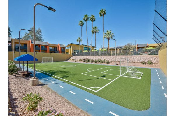 Soccer field with track and lighting.