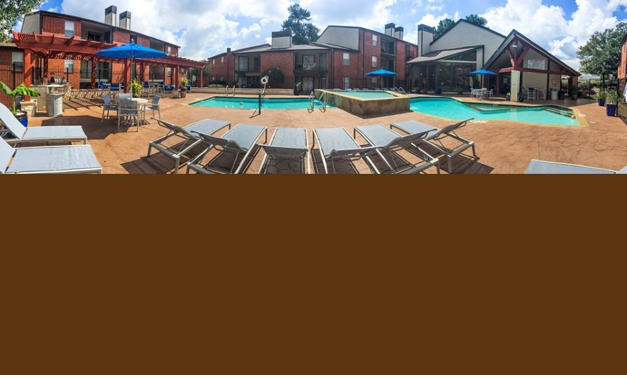 Wide View of Pool - The Timbers Apartments